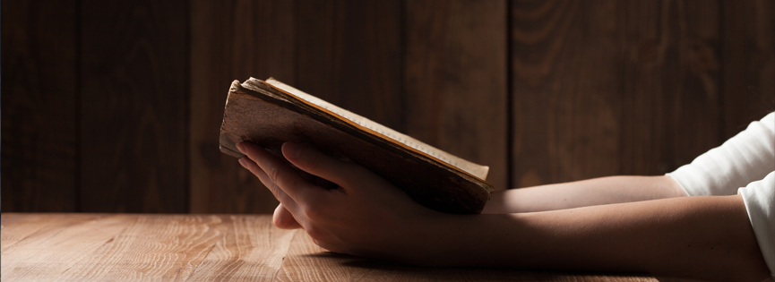 Reading Bible on Table
